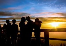 Silhouettes tourists are looking sunrise at view point Stock Photography