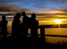 Silhouettes tourists are looking sunrise at view point Royalty Free Stock Photo