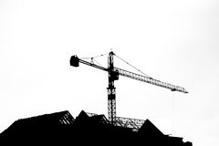 Silhouettes of tower crane at construction side. Picture is black and white style, not isolate stock images