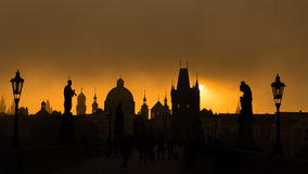 Silhouettes of towers and statues on Charles bridge during sunri Royalty Free Stock Photography