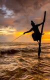 Silhouettes of the traditional Sri Lankan stilt fishermen Royalty Free Stock Photo