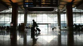 Silhouettes of traveller in airport.  stock video