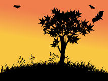 Silhouettes of tree and bats Royalty Free Stock Photos