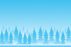 Silhouettes of trees on a snowy blue background. Stock Images