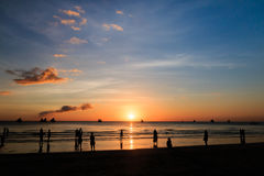 Silhouettes and a tropical ocean sunset Royalty Free Stock Images