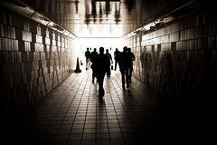Silhouettes in a tunnel Stock Photography