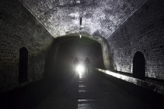Silhouettes in tunnel Stock Photography
