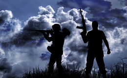 Silhouettes two armed soldiers Royalty Free Stock Image