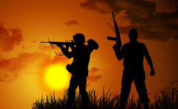 Silhouettes two armed soldiers Royalty Free Stock Images