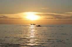 Silhouettes of two boats in the ocean at sunset. Raja ampat archipelago Royalty Free Stock Photography