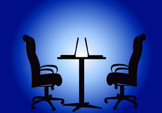 Silhouettes two chairs and table with computer Stock Photo