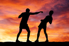 Silhouettes of two fighters Royalty Free Stock Images