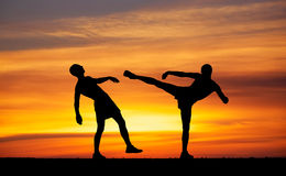 Silhouettes of two fighters Royalty Free Stock Photography