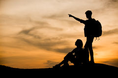 Silhouettes of two hikers with backpacks Royalty Free Stock Photo