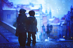 Silhouettes of two kids, standing on a stairs, view of Prague be Royalty Free Stock Image