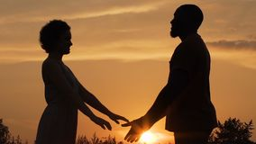 Silhouettes of two loving hearts stretching their hands to meet each other. Stock footage stock video