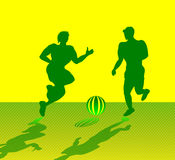 Two Muscular Men Playing Soccer Royalty Free Stock Photos