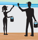 Silhouettes of two people painting a wall Royalty Free Stock Photography