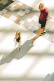 Silhouettes of two walking people royalty free stock images