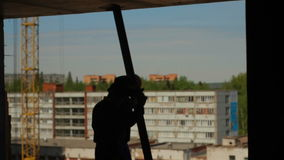 Silhouettes of two workers. With metal beam stock video