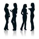 Silhouettes of two young women. Detailed silhouettes of two young women chatting with each other royalty free stock photos