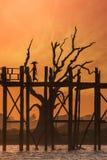 Silhouettes at U Bein teak bridge at sunset. Myanmar (Burma) Royalty Free Stock Photography