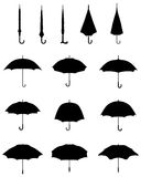 Silhouettes of umbrellas Stock Photography