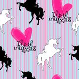 Silhouettes of unicorns white and black with lettering on a striped background seamless pattern vector illustration