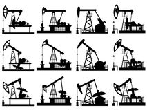 Silhouettes of units for oil pump. Royalty Free Stock Photos