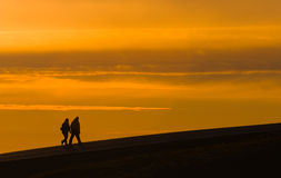 Silhouettes of walking people Stock Image