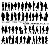 Silhouettes of walking people, caring bags, talking on the phone etc. Stock Photography