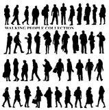 Silhouettes of walking people, caring bags, talking on the phone etc. Stock Images
