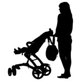 Silhouettes  walkings mothers with baby strollers Stock Photography