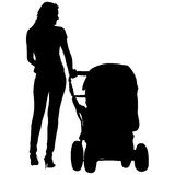 Silhouettes  walkings mothers with baby strollers Stock Image
