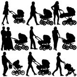 Silhouettes  walkings mothers with baby strollers Royalty Free Stock Photography