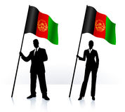 Silhouettes with waving flag of Afganistan Stock Photo