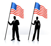 Silhouettes with waving flag of United States Royalty Free Stock Images