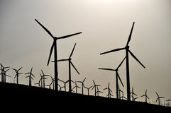 Silhouettes of wind power stations Royalty Free Stock Images