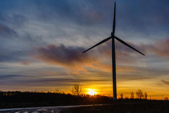 Silhouettes of wind turbines with a beautiful sunset Royalty Free Stock Image