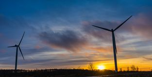 silhouettes of wind turbines with a beautiful sunset Stock Photo