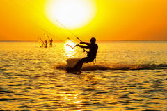 Silhouettes of a windsurfers stock image