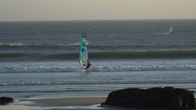 Silhouettes of windsurfers at the sunset. Spain stock video footage