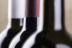 Silhouettes of wine bottles closeup stock photos