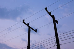 Silhouettes of wires. And electric post on sunset Royalty Free Stock Images