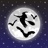Silhouettes of witches and bats Stock Images