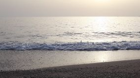 Silhouettes of woman girl running at sunset sea stock video footage