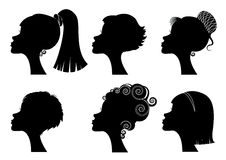 Silhouettes woman heads Stock Images