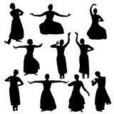 Silhouettes of woman performing bharatanatyam Stock Images
