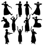 Silhouettes of woman performing bharatanatyam Stock Photos