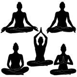 Silhouettes of woman sitting in meditation positions. Royalty Free Stock Photography